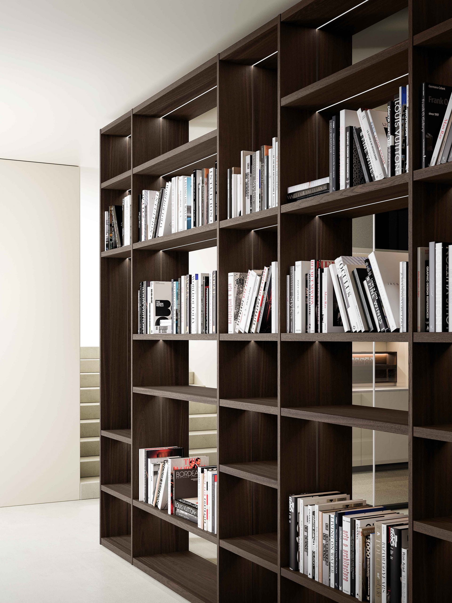 Wooden shelving system by Boffi holding books