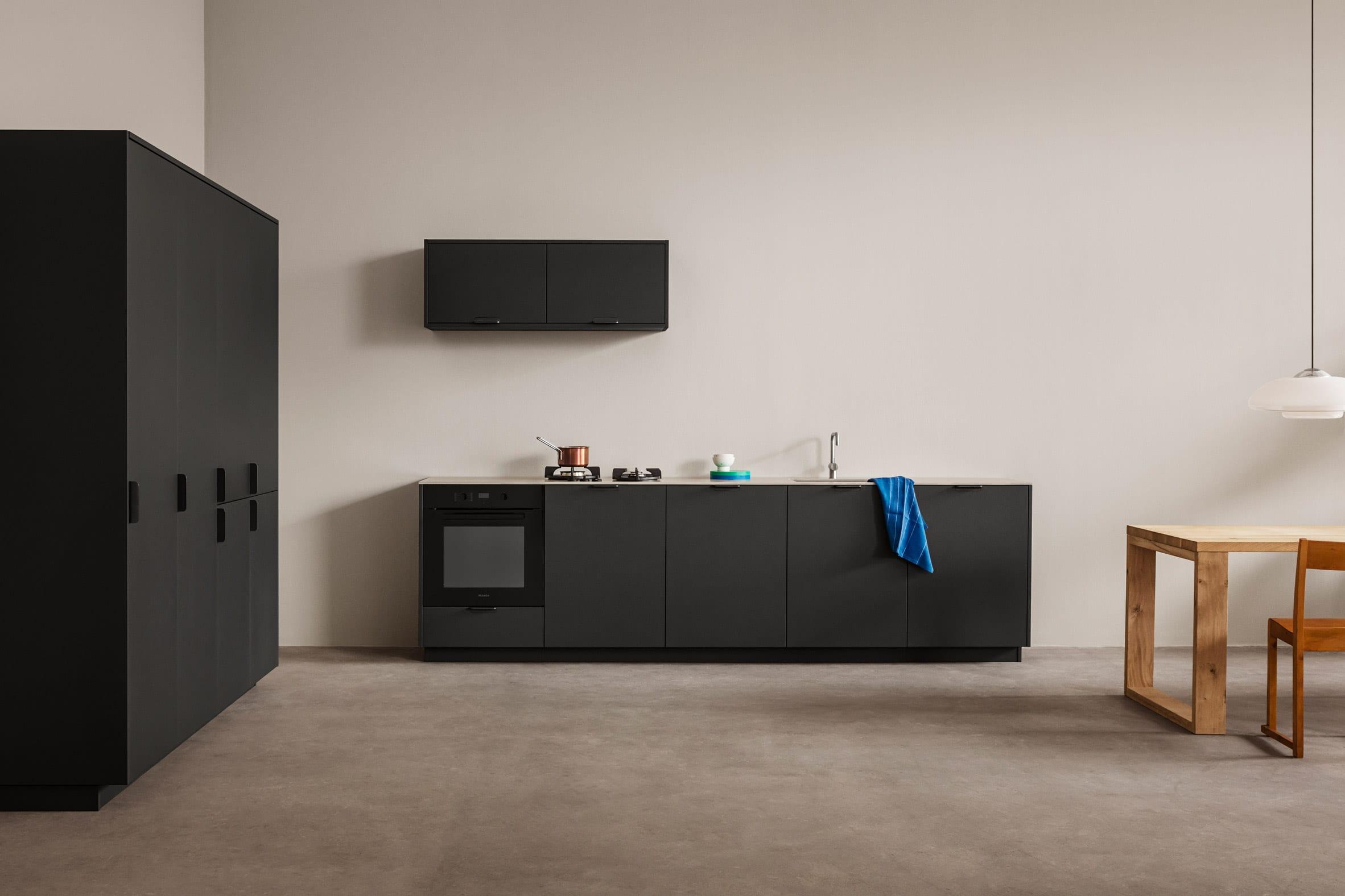 Matt black kitchen by Reform