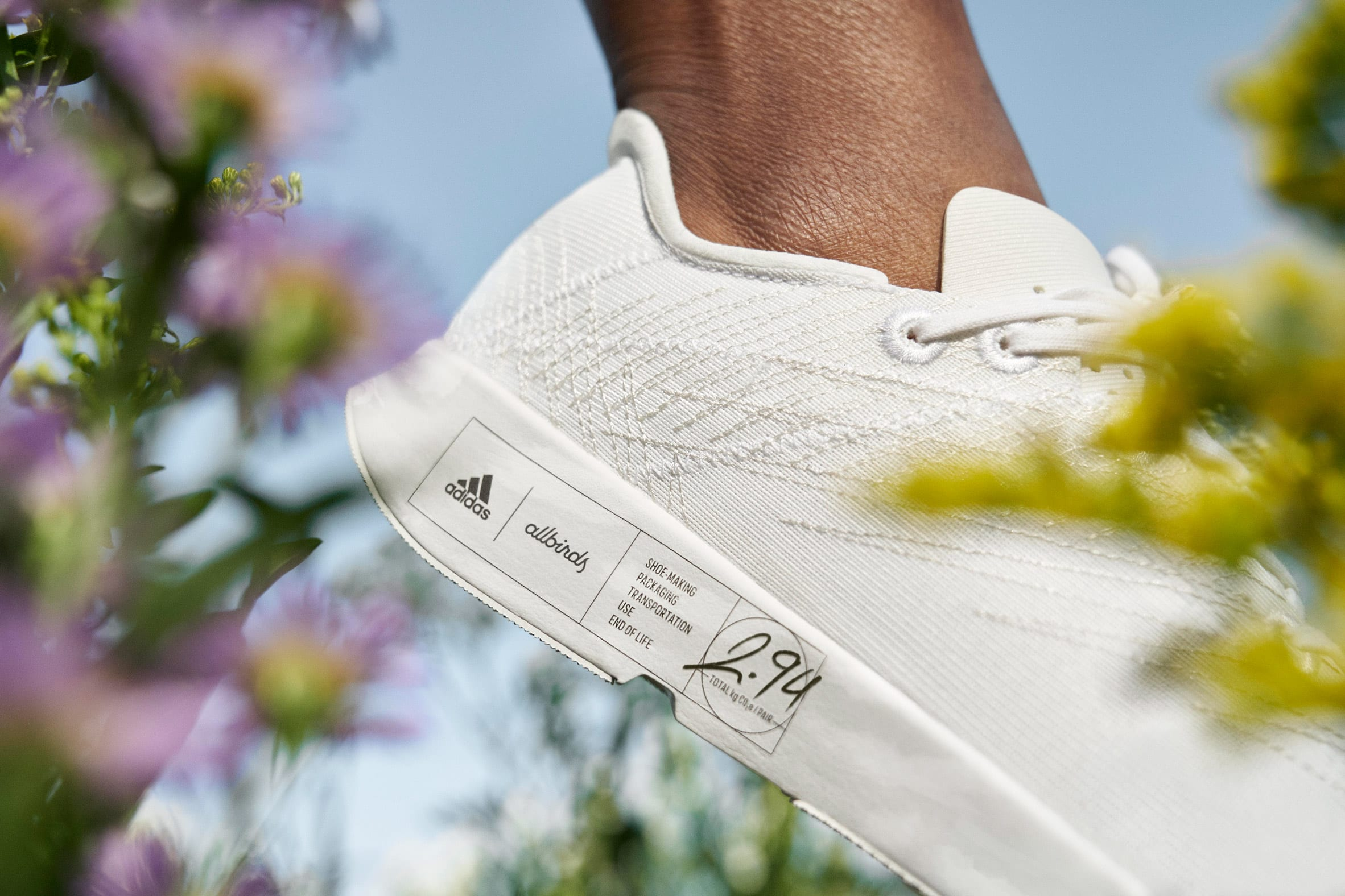 Close-up of carbon footprint label on Futurecraft.Footprint trainer
