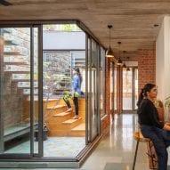 An internal courtyard has glass walls