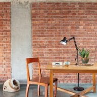 Brick and concrete covers the walls