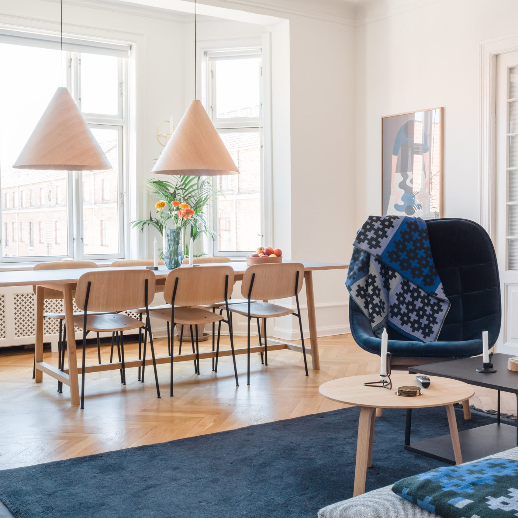A co-living space with a large dining table