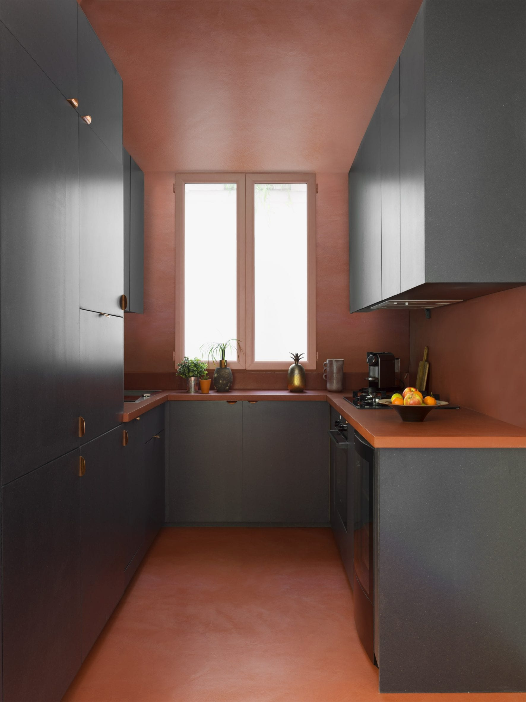 Red and black U-shaped kitchen