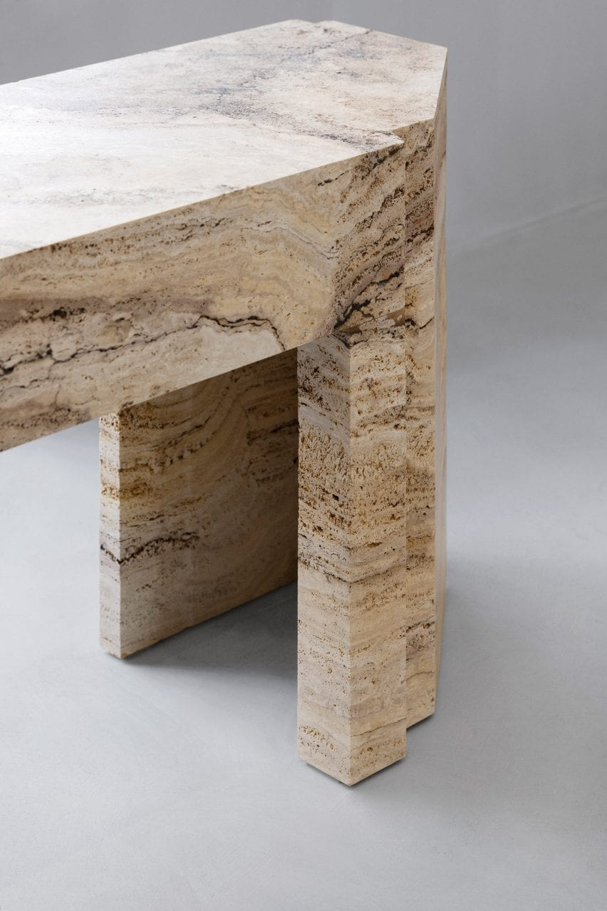 Close-up of travertine stone table in Axel Arigato Paris store