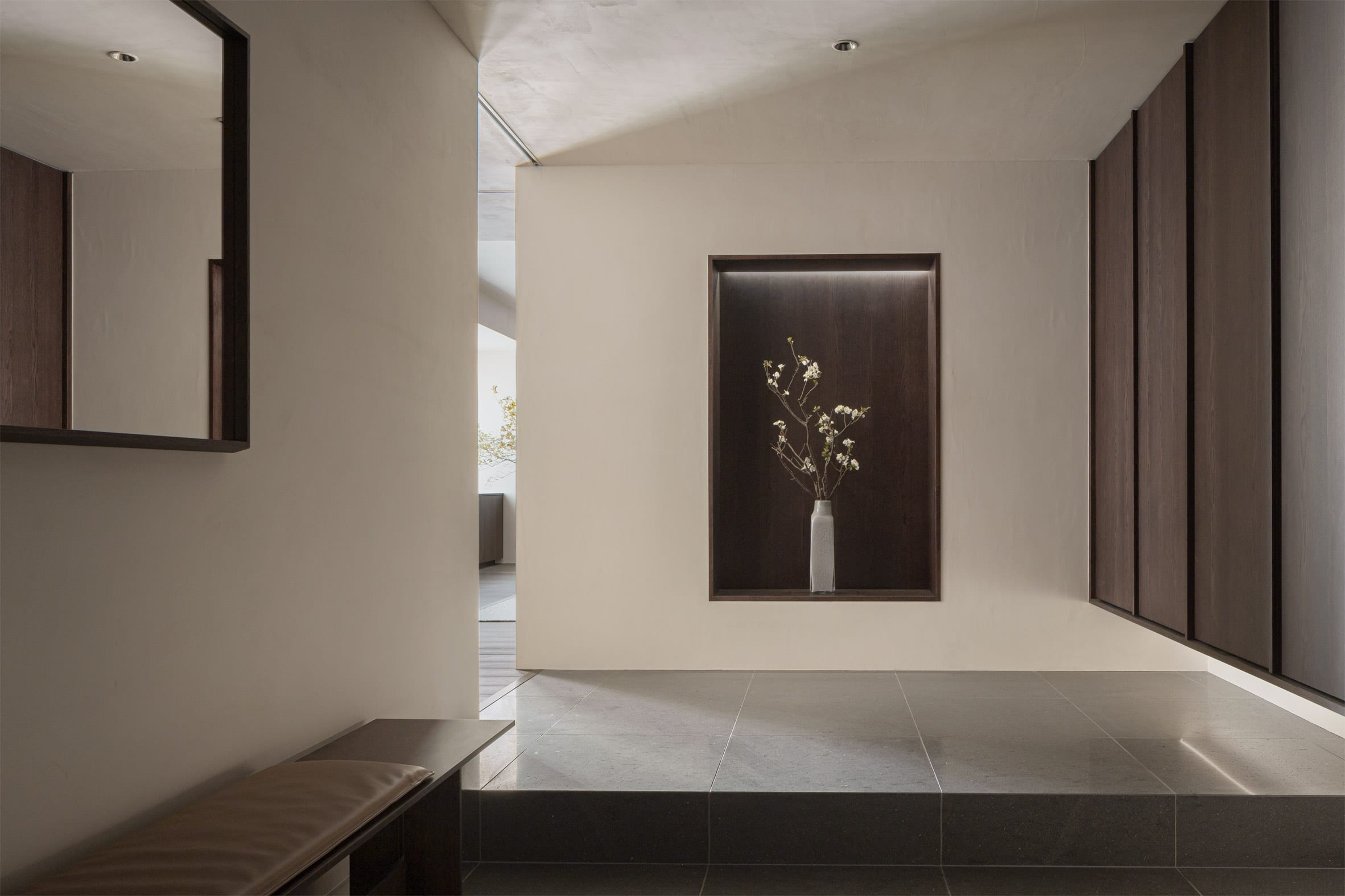 Entrance hall with stone floor in Tokyo apartment