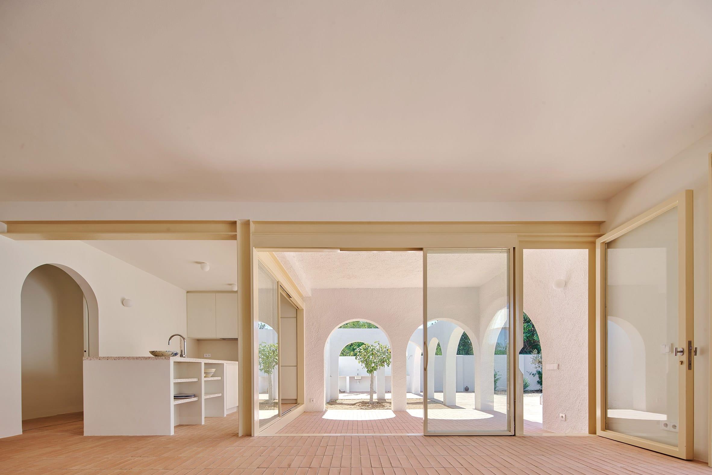 Glass doors open up to merge the indoor and outdoor
