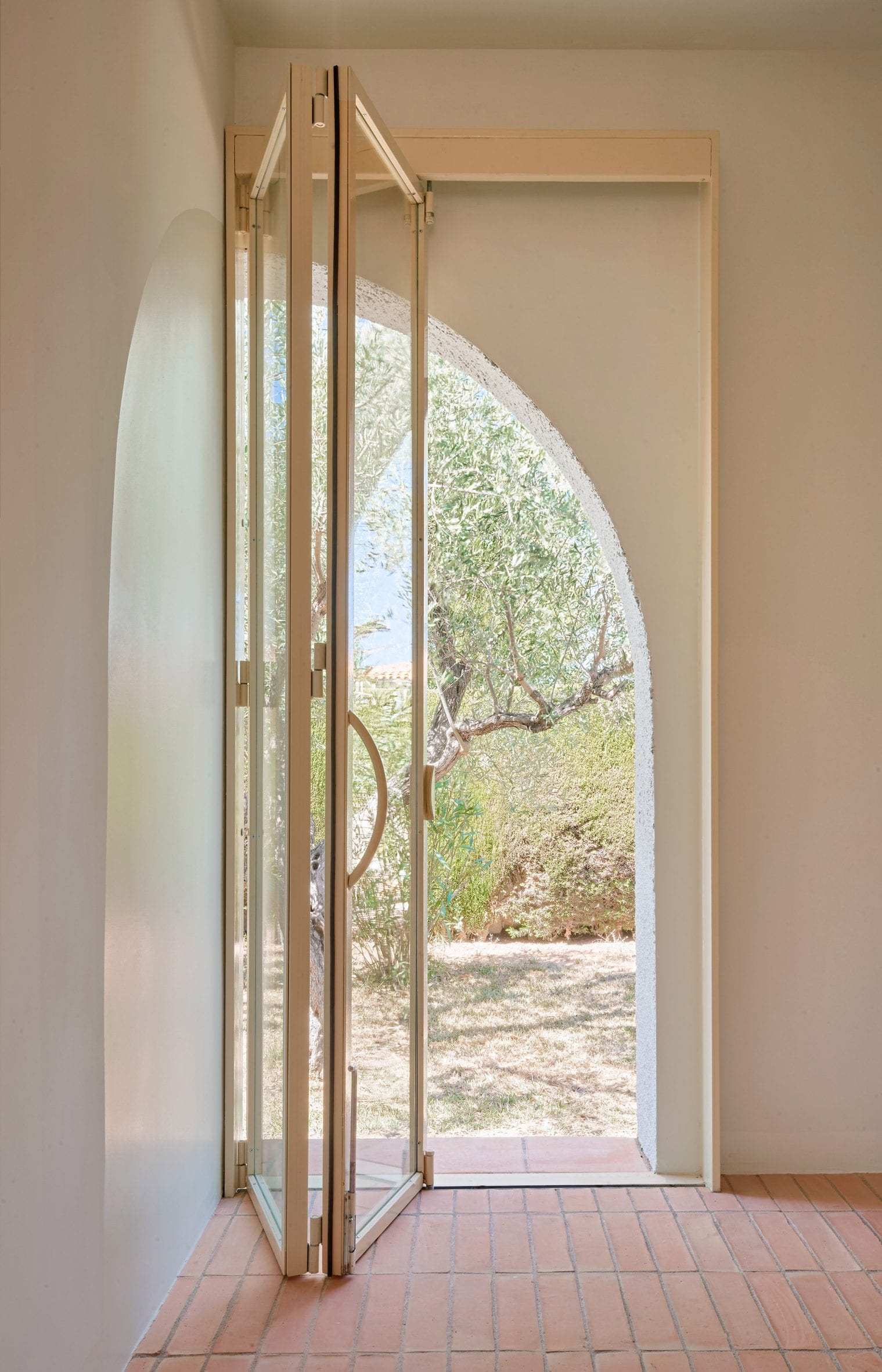 A glass door covers an archway