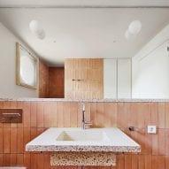 The bathroom has a terracotta interior