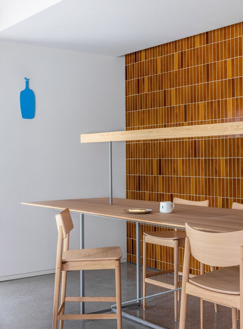 Tiled walls and a wooden seating table at Blue Bottle Coffee Shibuya
