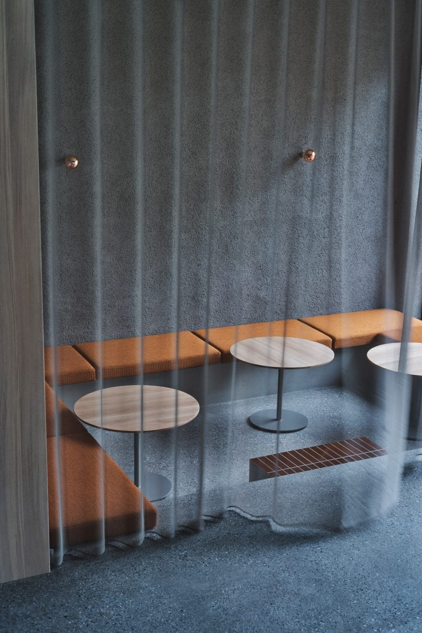 A sheer gray curtain over a sunken seating area in Blue Bottle Coffee Shibuya