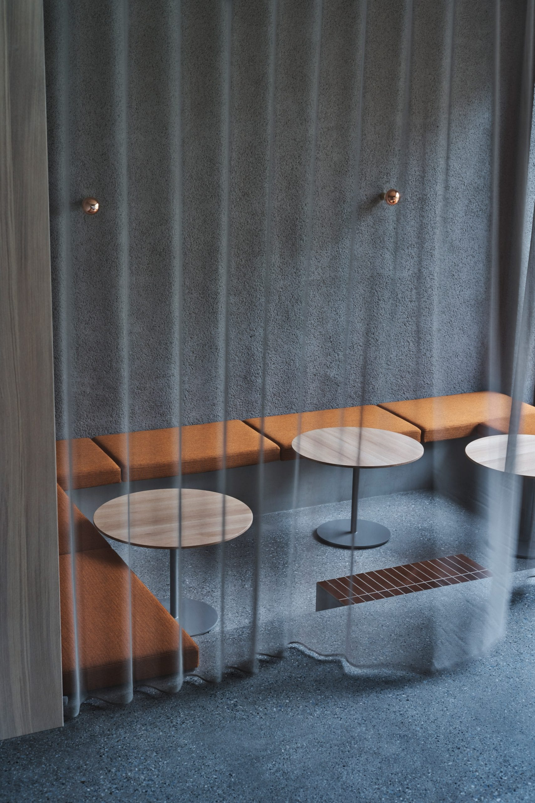Sheer grey curtain over sunken seating area in Blue Bottle Coffee Shibuya