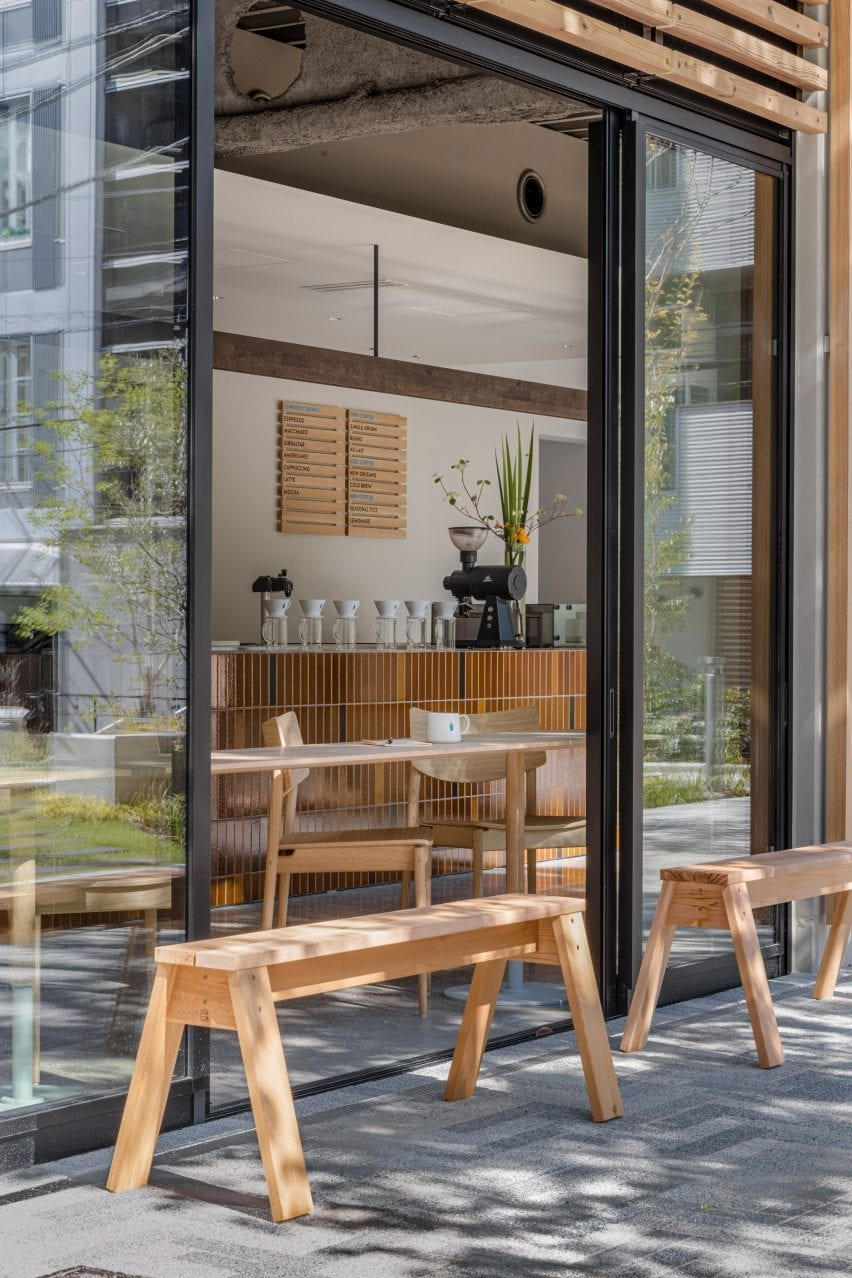 Wooden benches in front of Keiji Ashizawa Design cafe