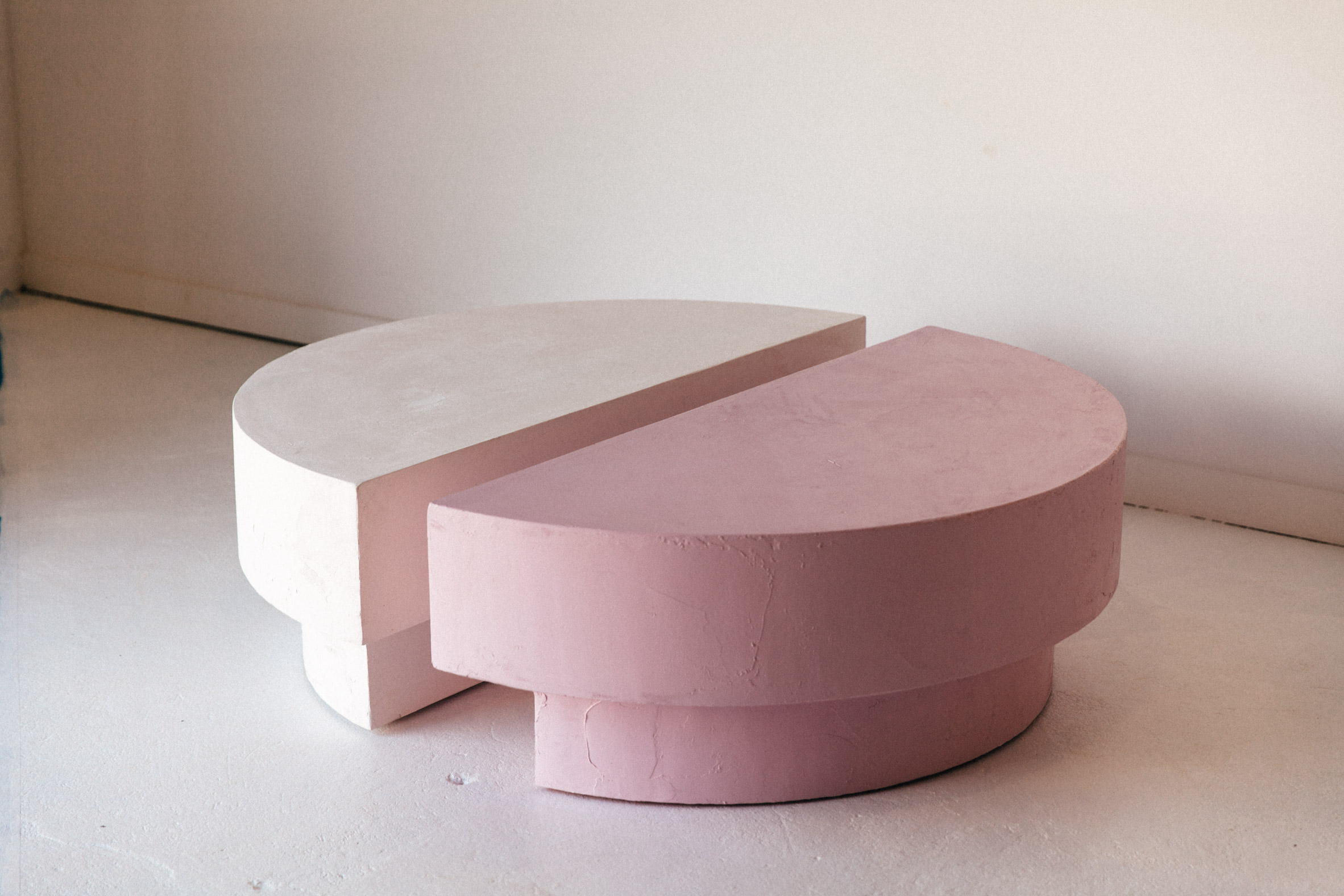 Abbott is a coffee table made of two crescent shapes
