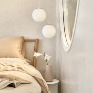 Pendant lights are located beside the bed