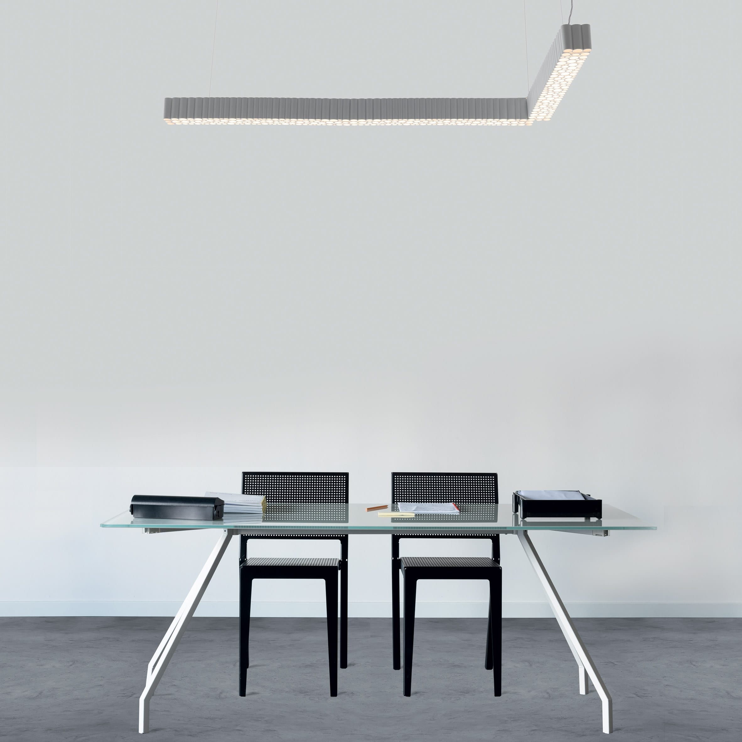 The Calipso light hanging above a table and chairs