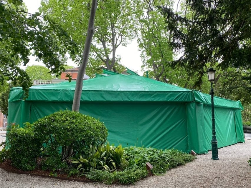 Canadian pavilion wrapped in green sheeting