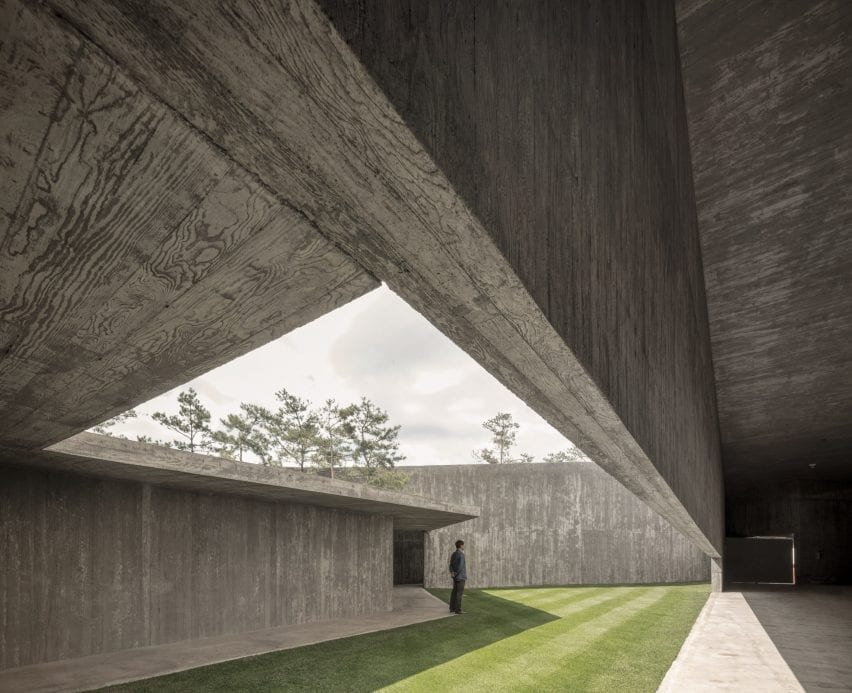 A covered walkway opens onto a courtyard