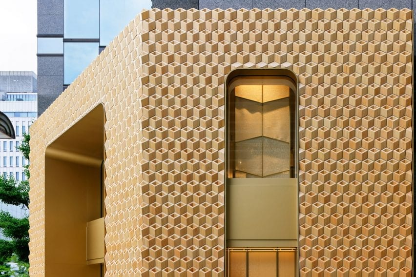The store by Klein Dytham Architecture has a golden tone