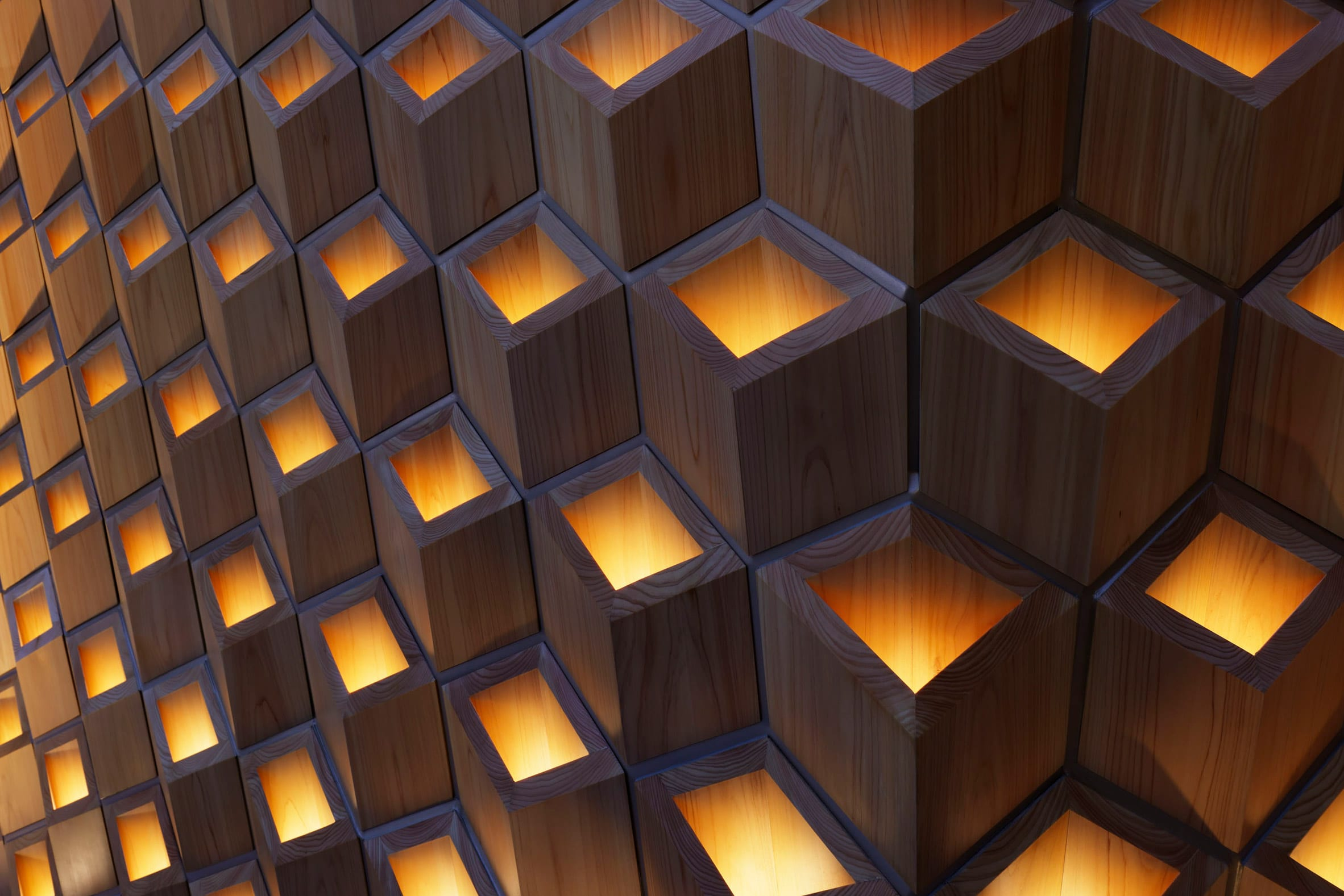 The facade by Klein Dytham Architecture glows from within