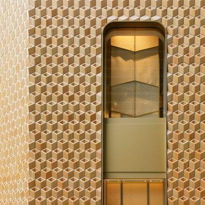 It has a golden hue to the facade