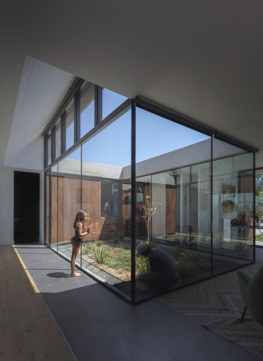 Glass courtyard open to the sky