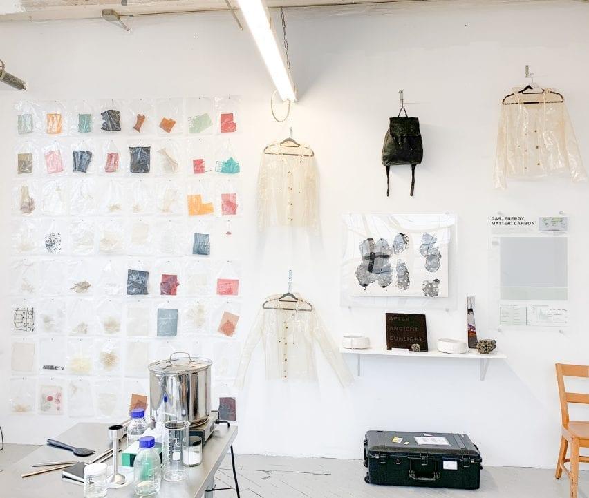 Bioplastic raincoats hanging on the wall in Charlotte McCurdy's studio