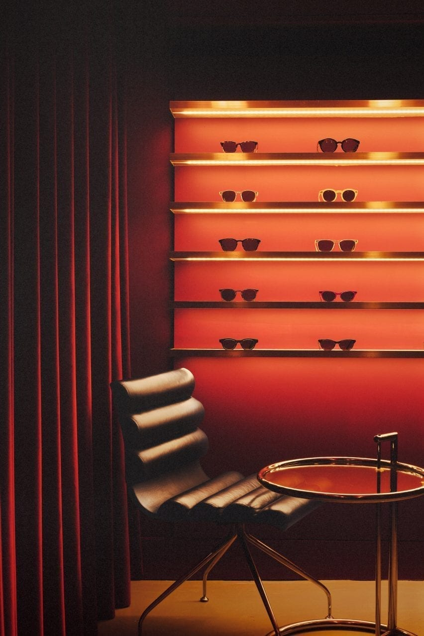 Leather chair with red glasses display in the Cubitts store