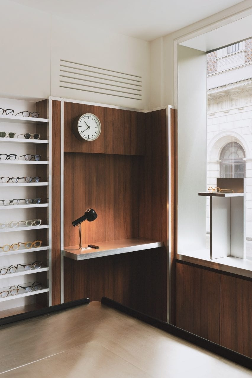 Work corner with clock display and glasses in the Child Studio eyewear store
