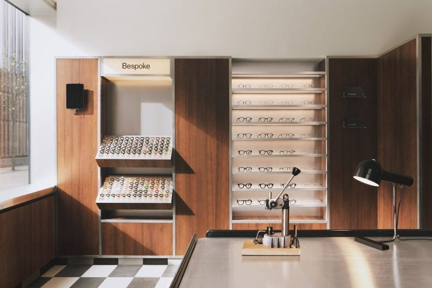 Wood-paneled walls and acrylic display stands in the Child Studio eyewear store