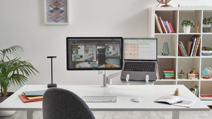 Colebrook Bosson Saunders' desk set up with Lolly desk light and laptop mount