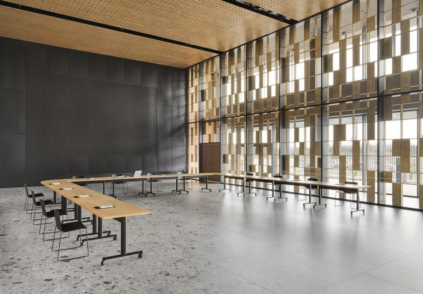 Series of Connect Tables that are joined in a U-shape in a hall