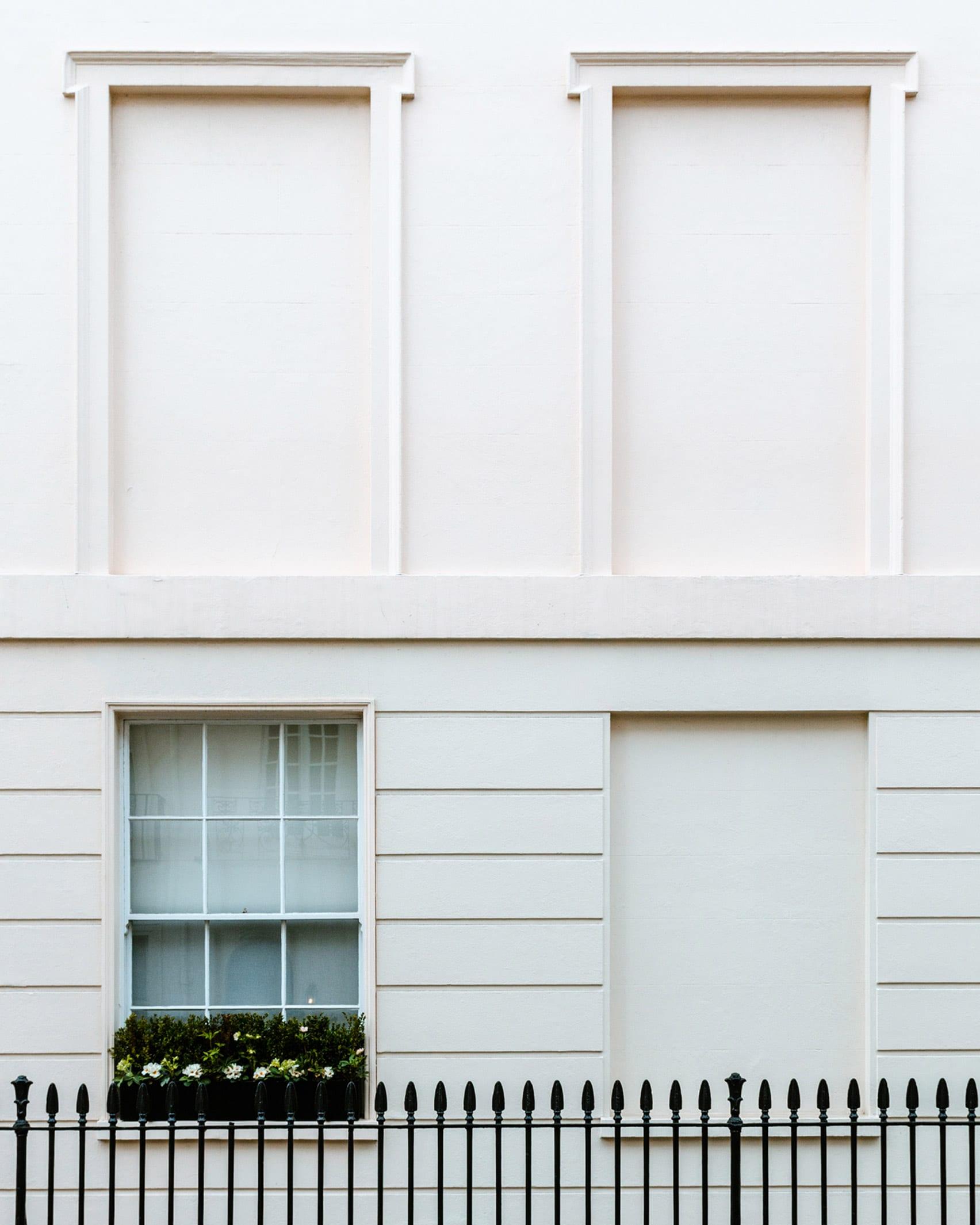 A white facade of a London house