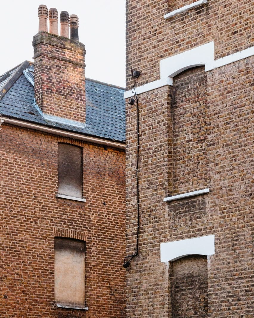 Brick houses in London with covered windows