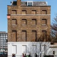 A windowless facade of London housing