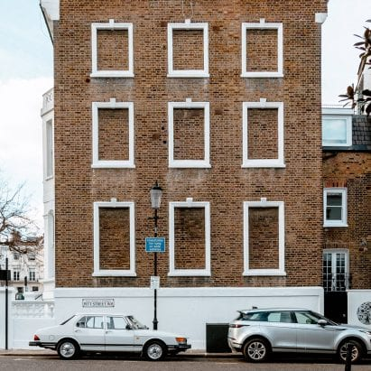 A facade with bricked-up windows in London
