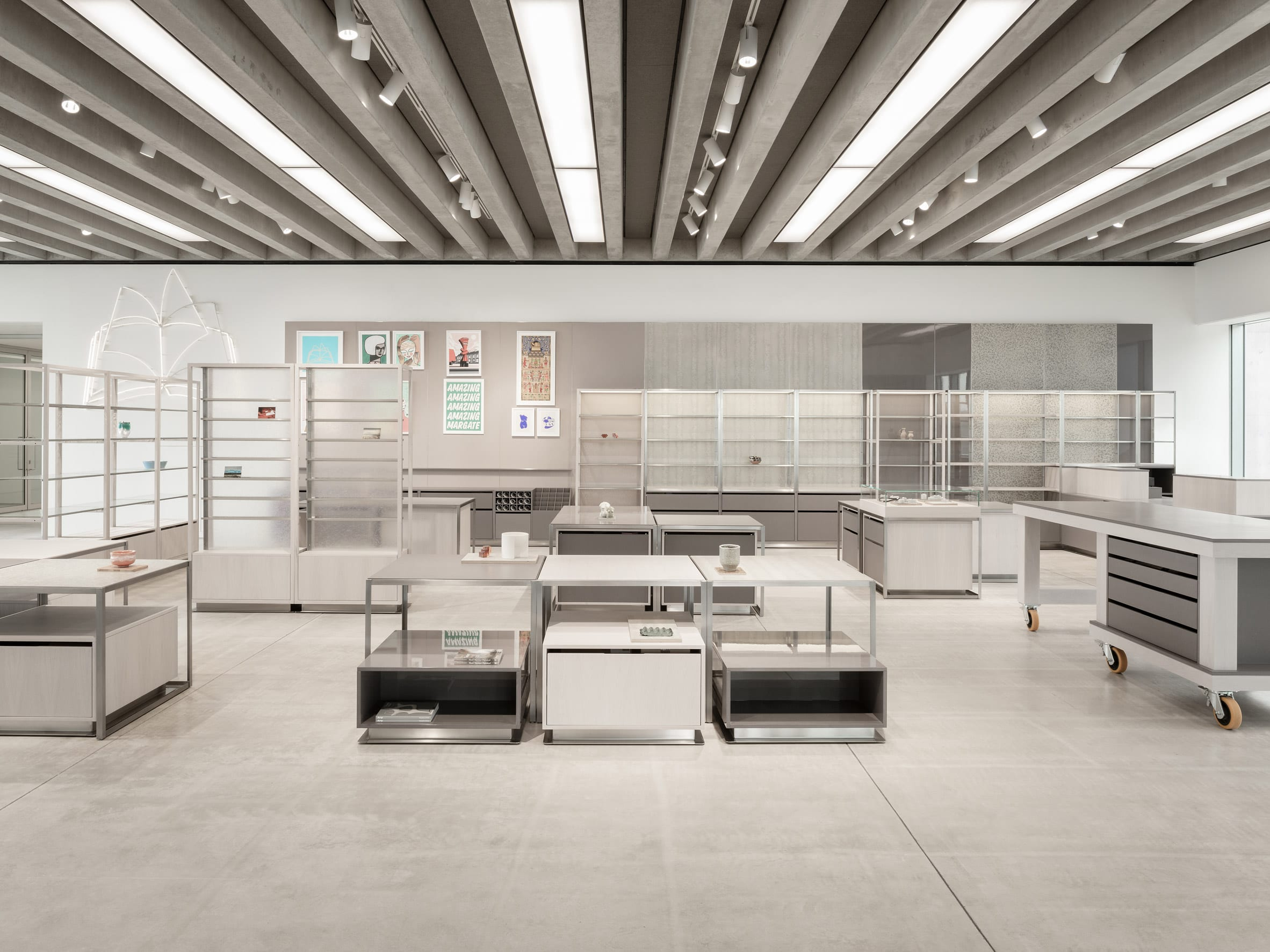 Shop interior by Daytrip with low display tables and a row of shelves