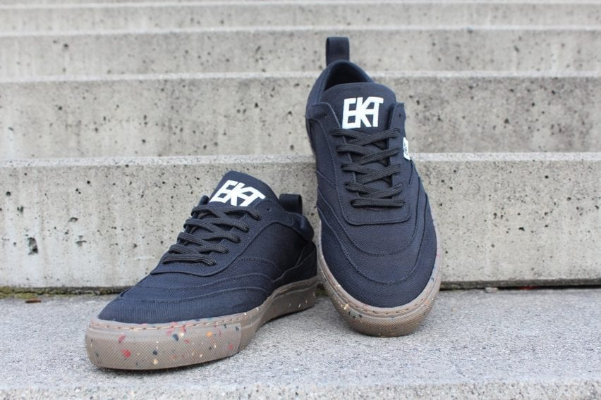 A pair of black Alchemy-X trainers