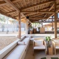 Estudio ALA designs El Perdido Hotel with rammed earth walls and thatched roofs