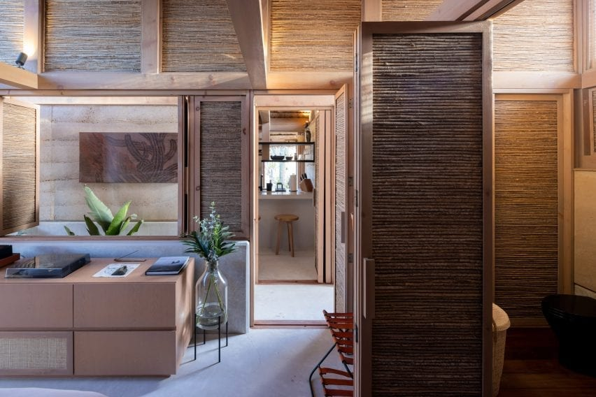 Hotel interiors thatch wood and concrete