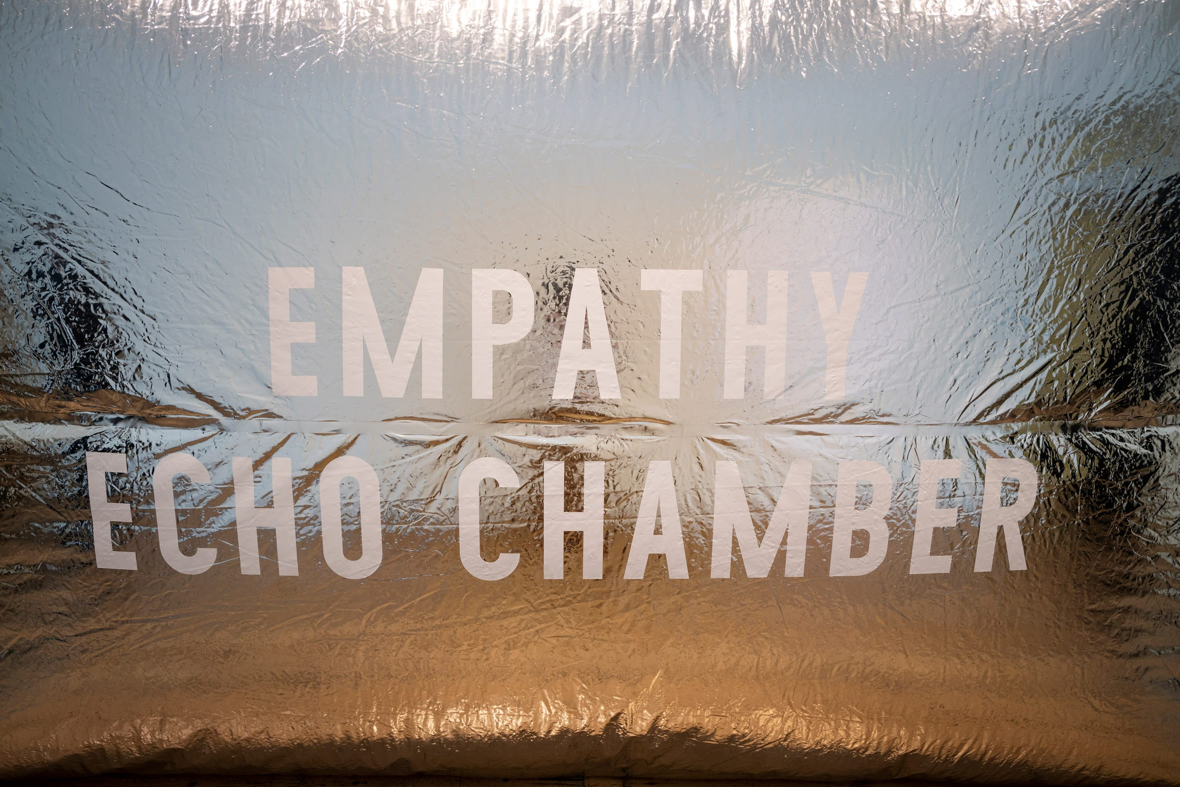 empathy echo chamber is printed on the side of the installation