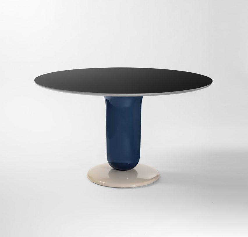 A pedestal dining table with a circular top