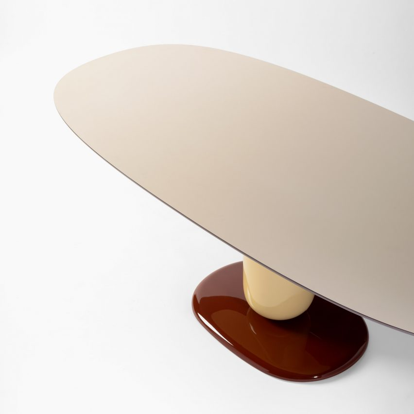 The oval-shaped tabletop of the Explorer dining table