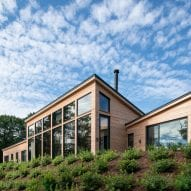 GRT Architects perches house for a throuple above tidal marsh in Connecticut