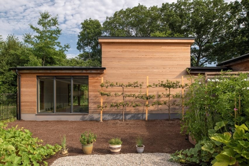 GRT Architects built a central courtyard between the house and workshop