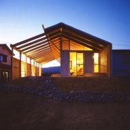 Exterior of timber framed house lit up at nighttime