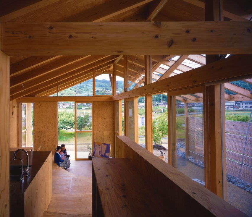 Barn-like timber home interior connected to the outdoors