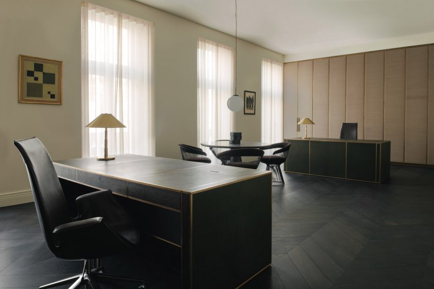 London office Hollie Bowden with matching desks and gold lamps