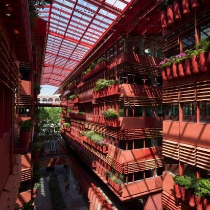 The building has red internal facades