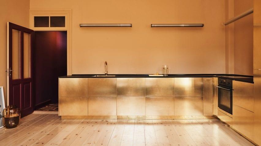 Golden hued kitchen by Reform