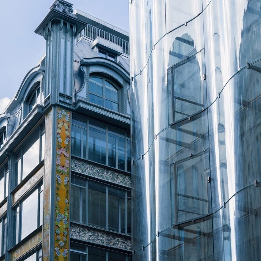 A historic and undulating glass facade